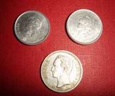 Lote de tres monedas antiguas argentinas